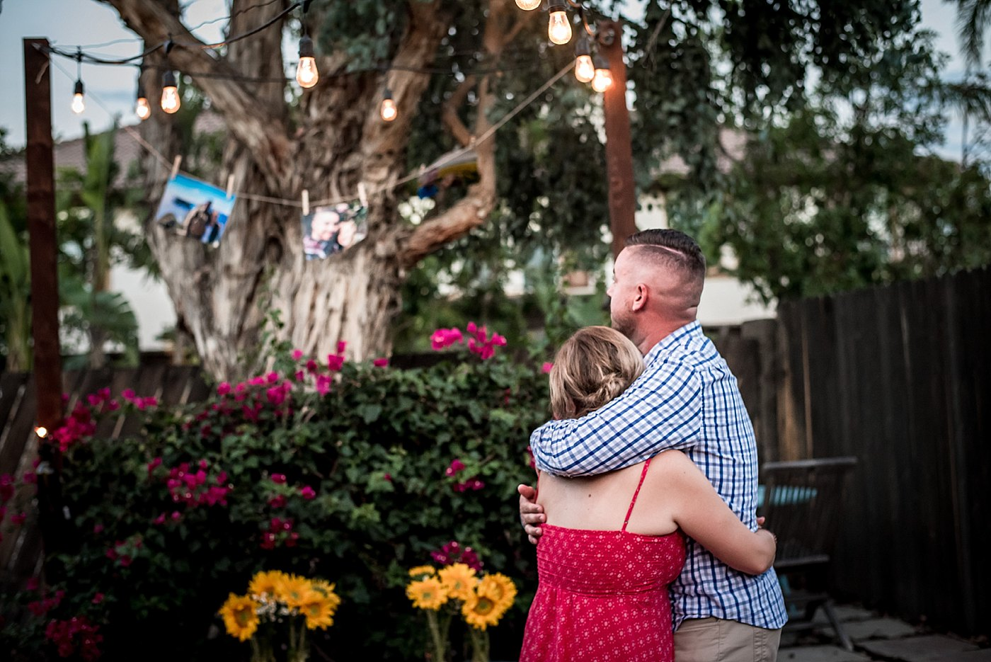 man woman cuddle backyard proposal redlands family photographer