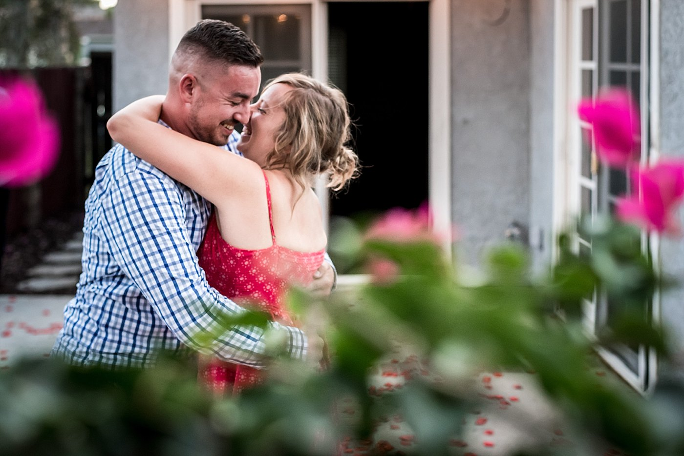 man woman hug backyard proposal redlands family photographer