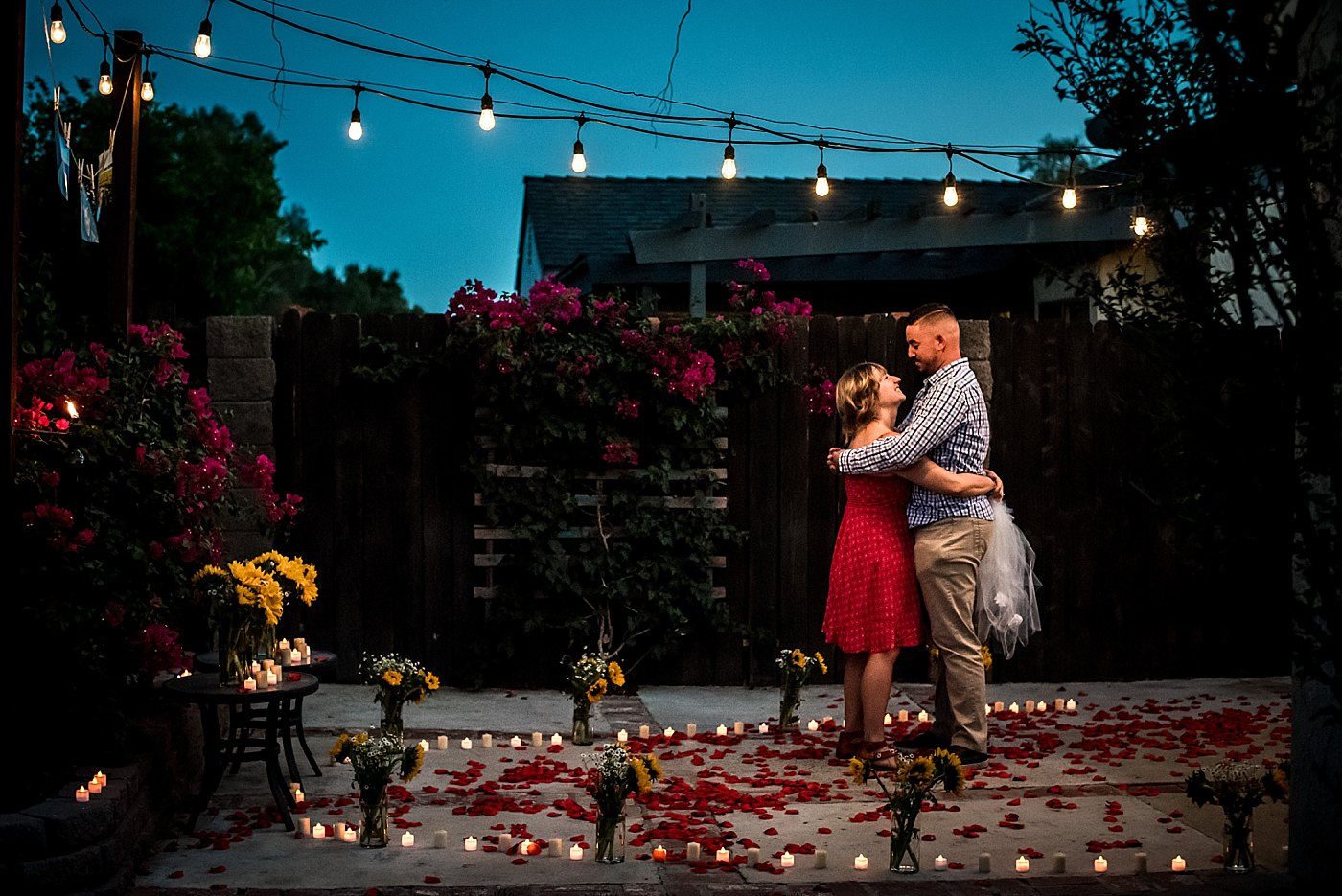 man woman dance under lights backyard proposal redlands family photographer