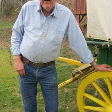 J. Garrett with Carver Covered Wagon