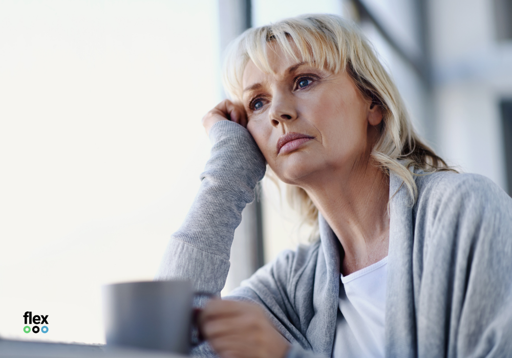 photo of woman looking thoughtful, imposter syndrome
