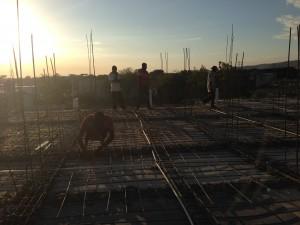Haitians working on the roof in Onaville Haiti