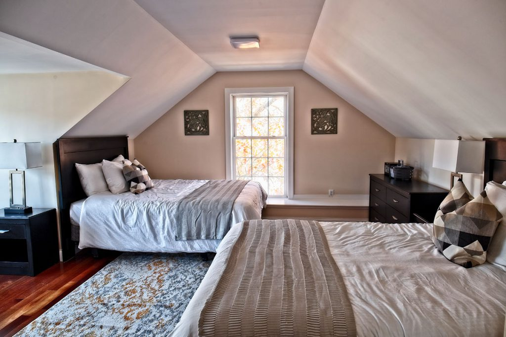 Bedroom with two beds and window