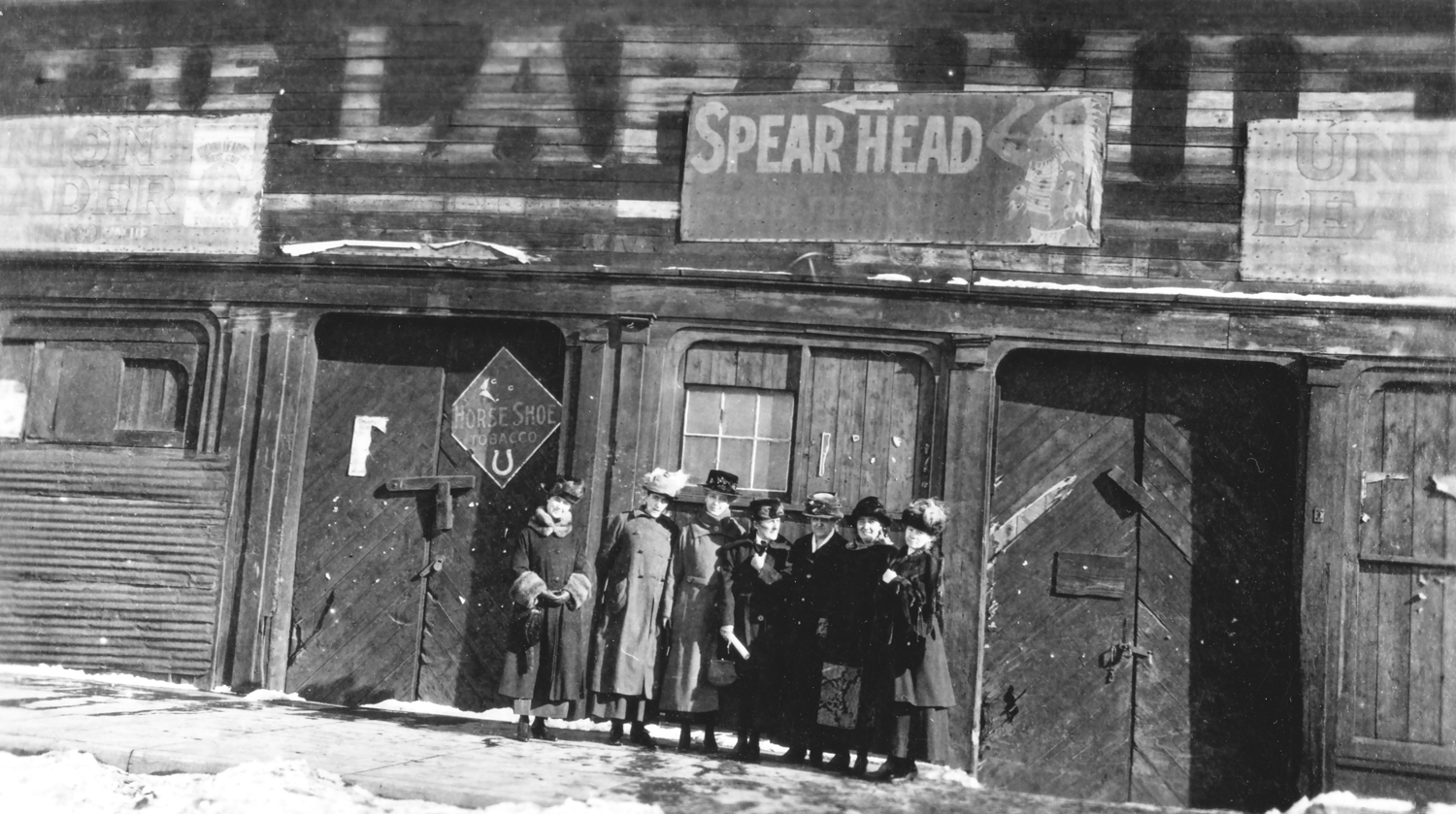 The first females jurors gathered in front of the first courtroom in Laramie – The Blue Front (notorious as Con Moyers (831) Bar, then a theatre for traveling acting troops, later August Trabing used it as his fist store in Laramie)