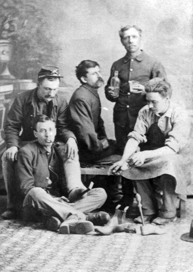 665--5-men-posing-for-photograph-in-studio,-Eugene-Issac-bootmaker-on-R,-Ft-Sanders-dura