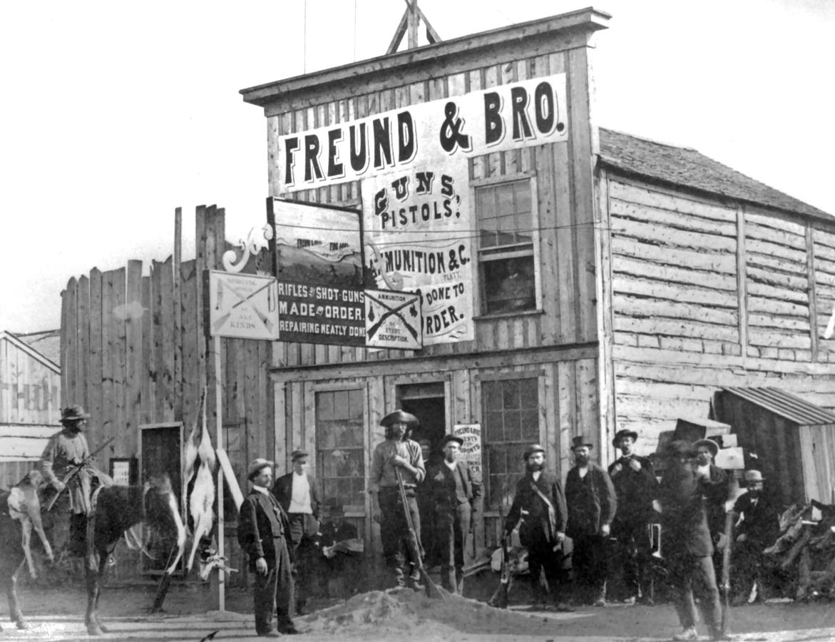 863-Exterior-of-Freund-&-Bro-Gun-Shop,-Laramie,-DT-1868-1-dura