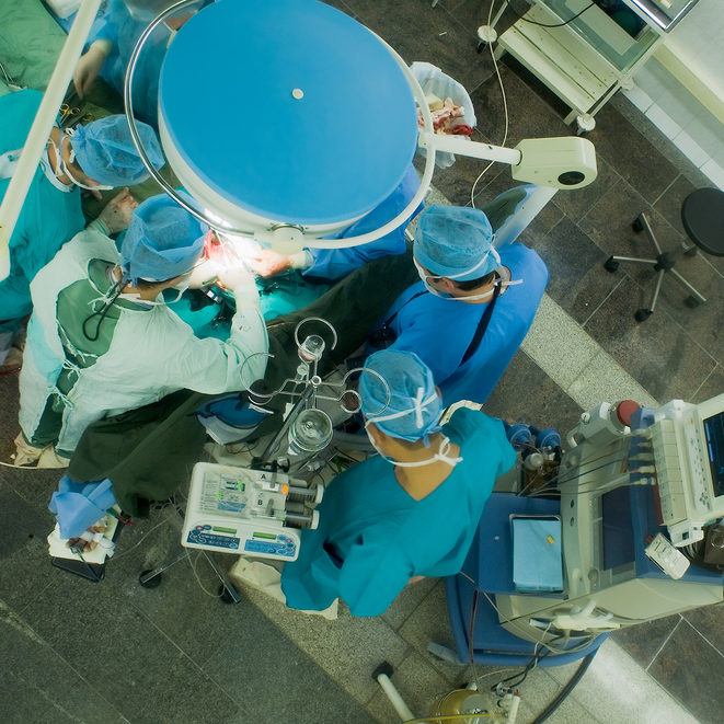 surgeons working in operation room. view from above