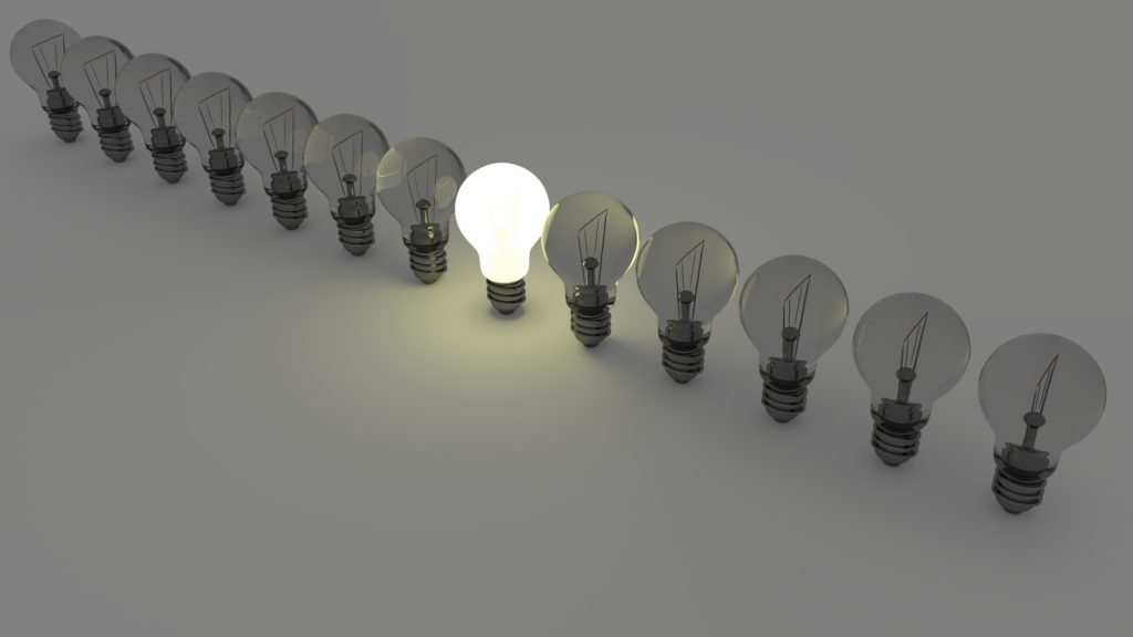 one light bulb stands out from crowd