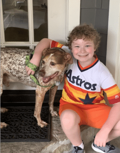 Maddox meeting Tipton, our rescue dog