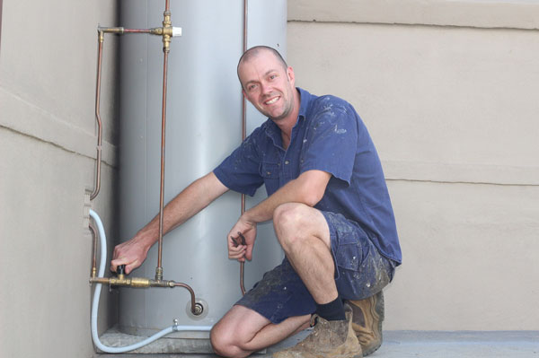Dave installing a hot water heater in Kiama.