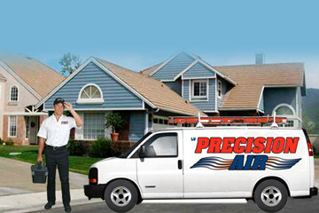 A technician and Precision Air in a neighborhood.