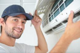 A man repairs a temperature controller.