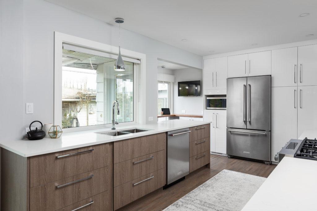 Oak brown wood veneer cabinet fronts, caesarstone, counterdepth french door fridge, coffee bar