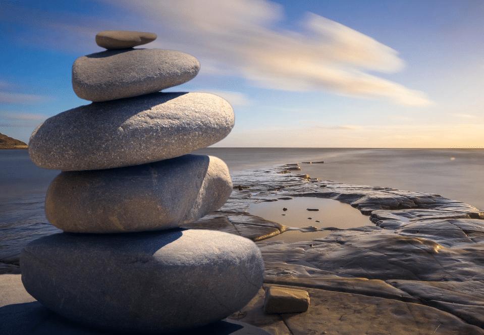 Rocks stacked on the beach to represent integral breath therapy