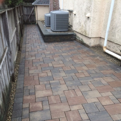 After paver walk and utility area