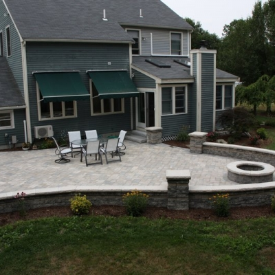 After large patio, firepit and seating wall with piers 7