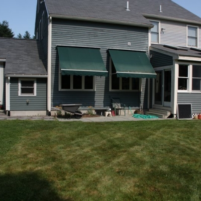Before large patio, firepit, and seating wall with piers 7
