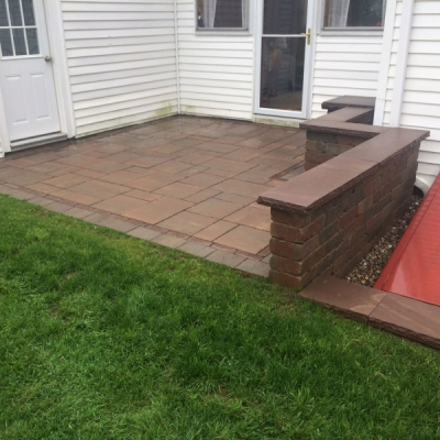 After paver patio and segmented retaining wall with granite coping