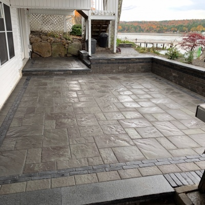3 tiered patio with seating walls with lighting