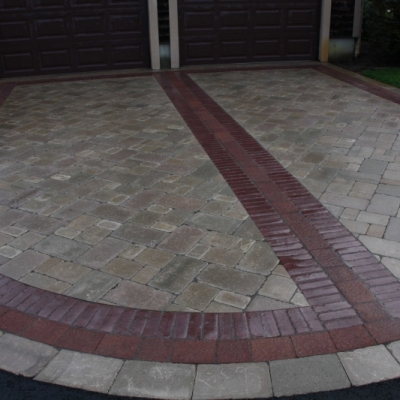 Sandstone Brussels pavers with a Burgundy Red Copthorne interior border and a Heritage Brown Il Campo interior border with a Sandstone Brussels paver exterior border