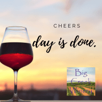 photo of wine glass with red wine against a sunset. words say Day is done.