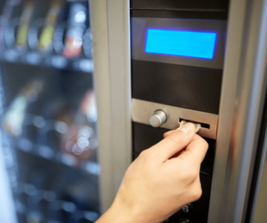 Looking through vending machine payment options.