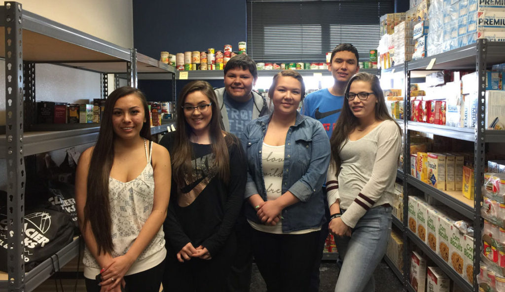 Browning High School Students in local food bank pantry