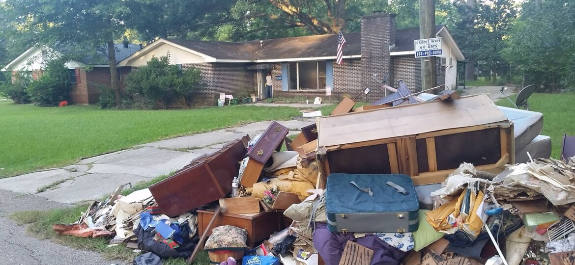 Home with interior debris on front curb
