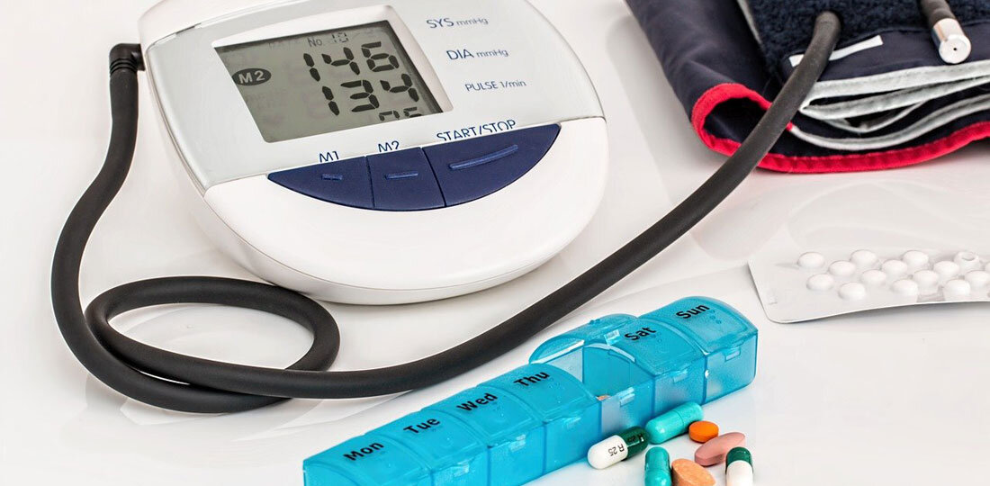 Blood pressure medication in front of a monitor