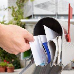 Hand in mailbox