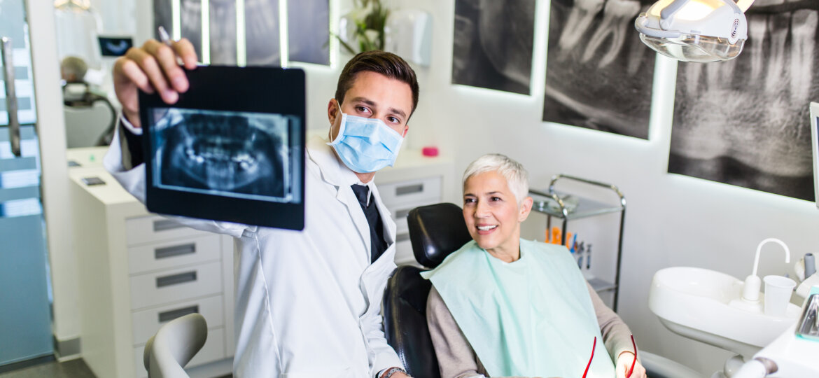 Woman sitting with dentist