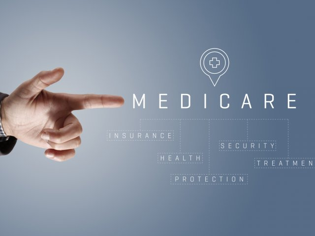 Hand pointing to Medicare