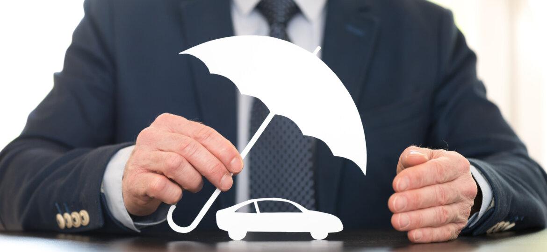 Paper car under umbrella