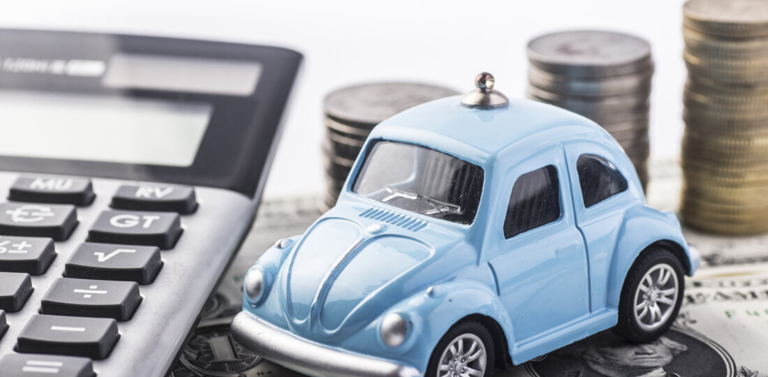 Blue toy car and money