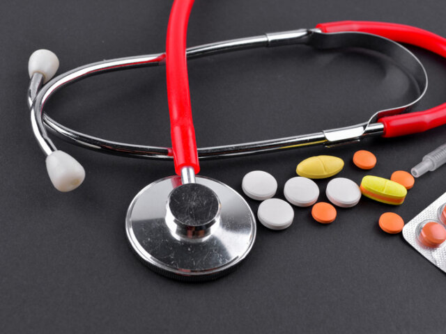 Red stethoscope and medications