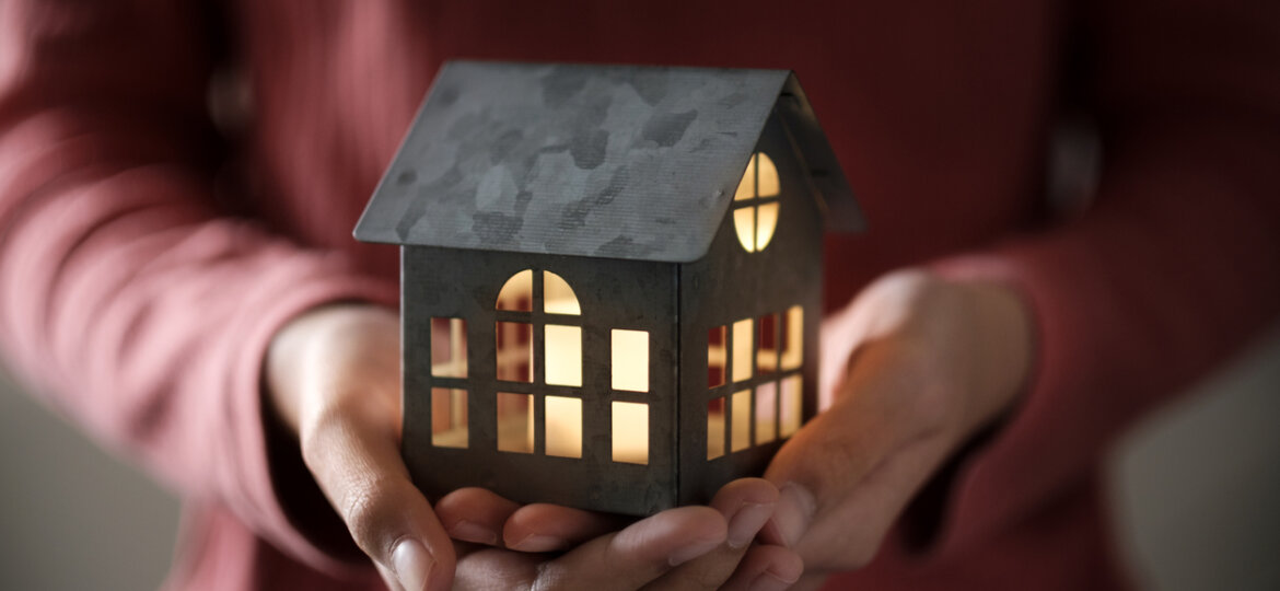 Illuminated home in hands