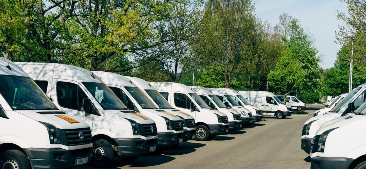 Line of white commercial vans