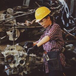 Woman working on engine