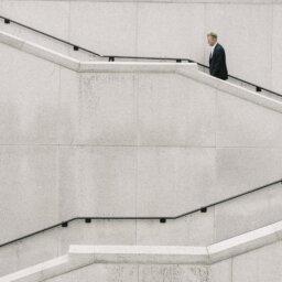 Man climbing white stairs