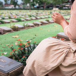 Woman in front of grave