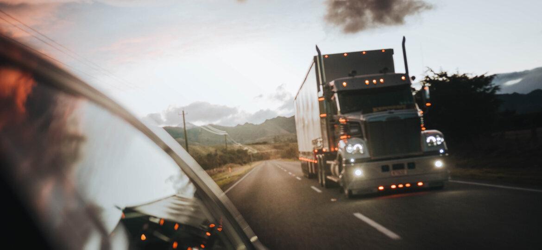 Semi in rear view mirror