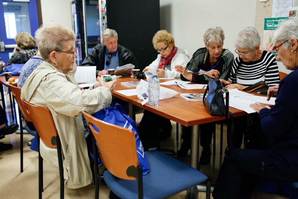 seniors reviewing resources at Housing Forum