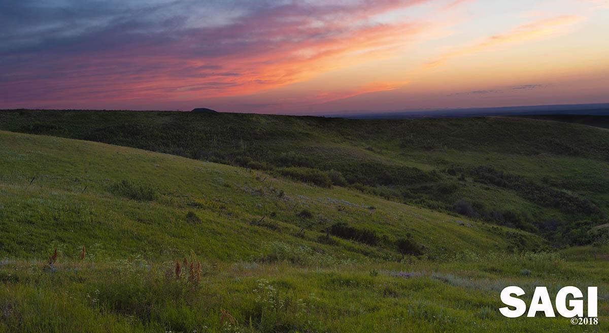 Sunset over Great Falls Montana, Montana sunset, dusk in Montana, colorful sunset over a green field, Guy J. Sagi Photography