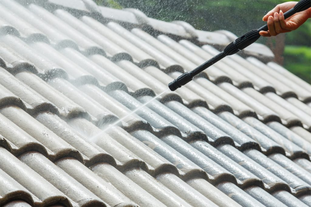 Roof cleaning and pressure washing by Affordable Roofing by John Cadwell, Inc