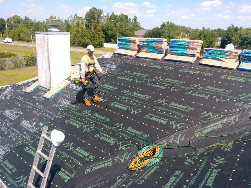 Affordable Roofing installing Underlayment for Roof in Tavares, FL