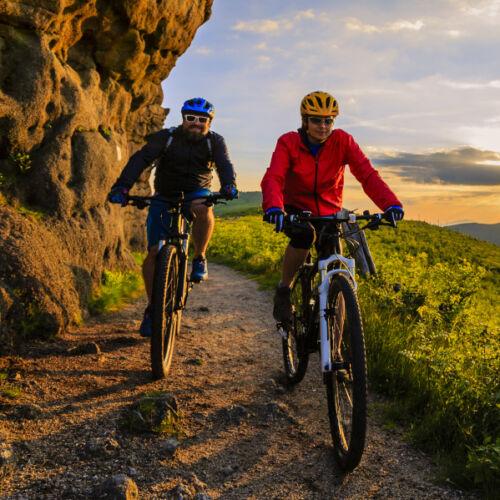 man and woman riding mountain bikes_600