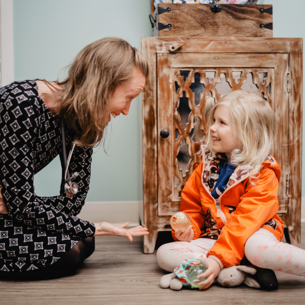 Naturopathic doctor with pediatric patient