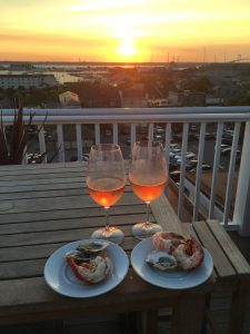 Wine with crab claws at the balcony