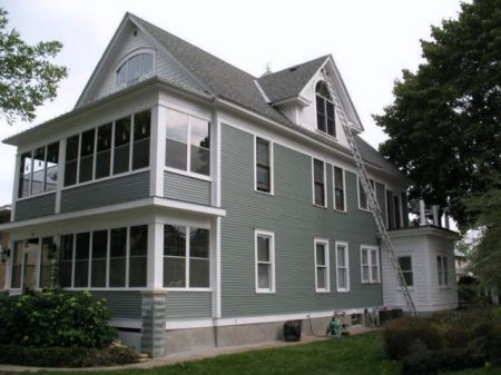 victorian house with gray siding, exterior