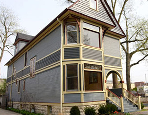 gray house with yellow and red trim, exterior